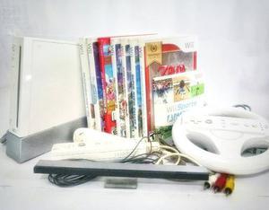Nintendo Wii + 2 Controles + Un Nunchuk + 8 Películas