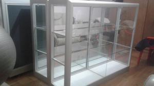 3 vitrinas estructuradas en vidrio y aluminio crudo