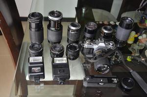 camara canon AE 1 DE ROLLO con lentes, puedo cambiar por