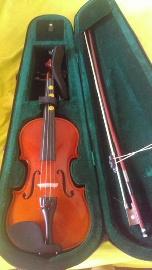 violin mc art 1/2 casi nuevo con estuche y acomodadera.