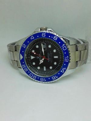 Reloj Rolex Plateado con Borde Azul