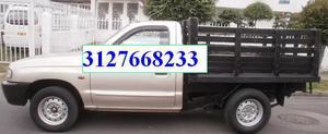 servicio de transporte en camioneta, botada de escombros,