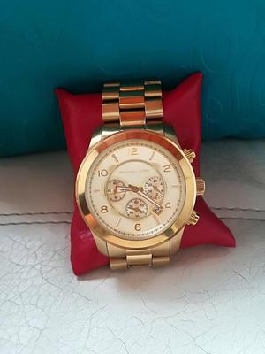 vencambio reloj michael kors original dorado.
