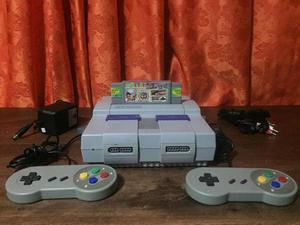 Super Nintendo SNES con 2 controles y un caset multi juegos