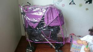 Coche para bebe color púrpura con silla para el carro