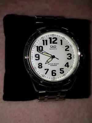 Reloj Qq