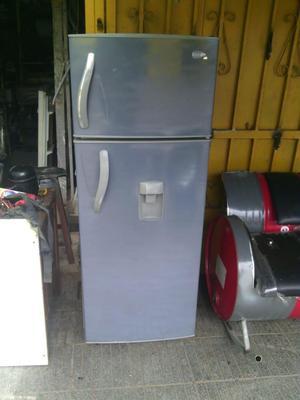 nevera usada marca CENTRALES de 218 litros con escarcha