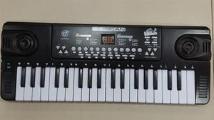 Organeta Keyboar Piano Usb Micorfono Cargador de Pared