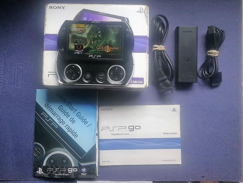 psp go en caja memoria de 16 gb 45 juegos psp  juegos en