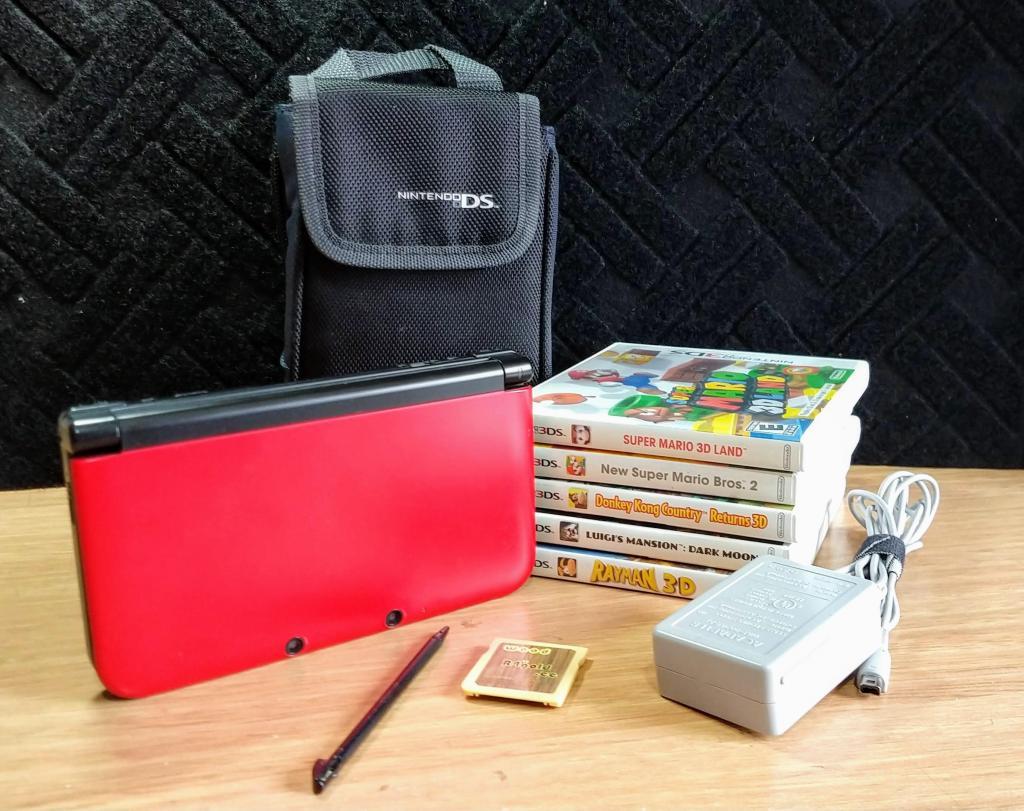 Nintendo 3DS XL Programada con 130 juegos. Estuche original.