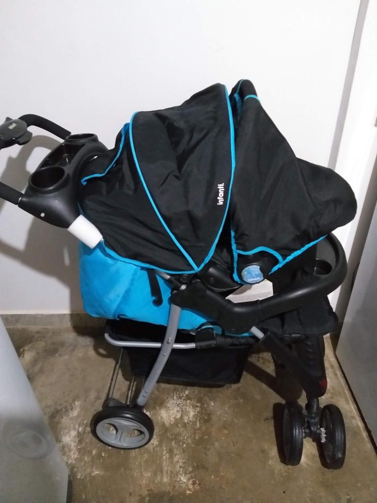 Coche marca infanti, con porta bebe para carro