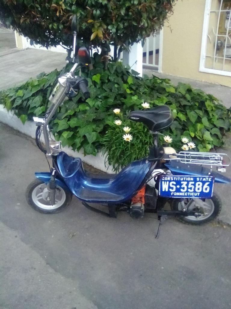 Scooter dos tiempos..Divina fácil de transportar...