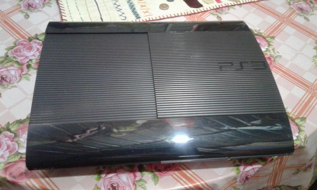 VENDO O CAMBIO PS3 SUPER SLIM 500GB POR PS4 ENCIMO, TELEFONO