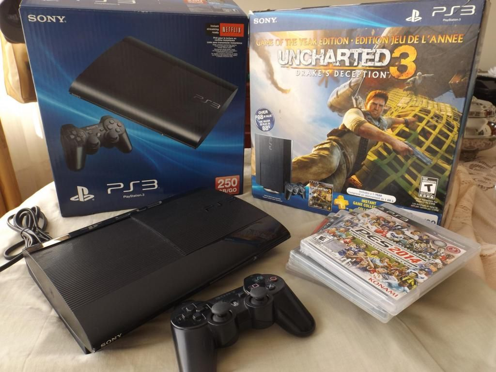 Playstation 3, con 1 control y 5 juegos