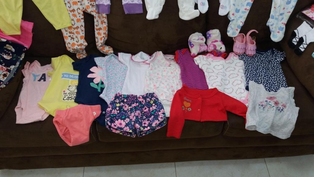 lote de ropa de niña de 0 a 6 meses.